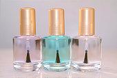 Close-up of three bottles of clear nail polish