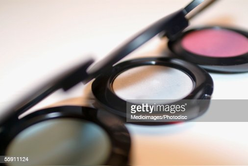 Close-up of three eyeshadow palettes : Stock Photo