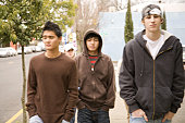 Close-up of three teenage boys walking