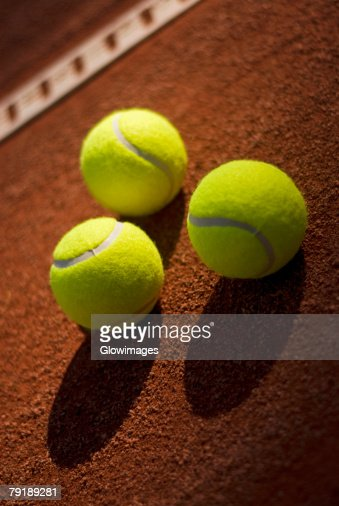 Close-up of three tennis balls in a court : Stock Photo