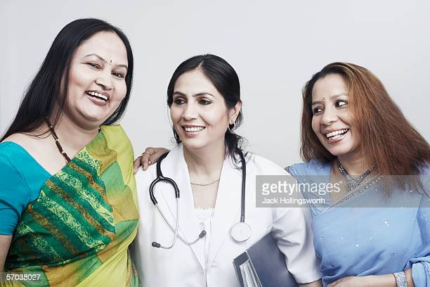 Close-up of three women smiling