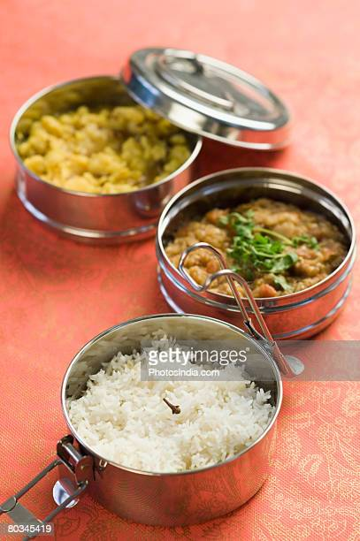 Close-up of tiffin boxes of rice and curry