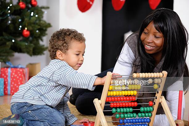 Close-up Of Toddler and Mother Enjoying Playtime At Christmas