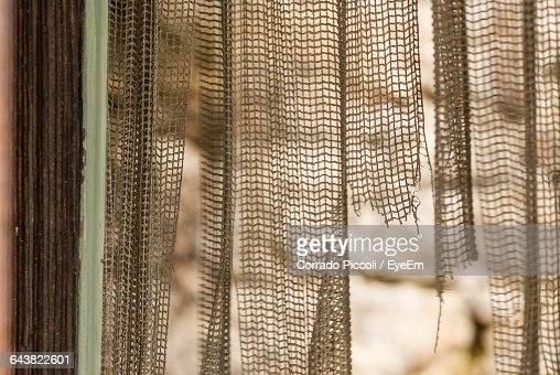 Close-Up Of Torn Curtain At Home : Stock Photo