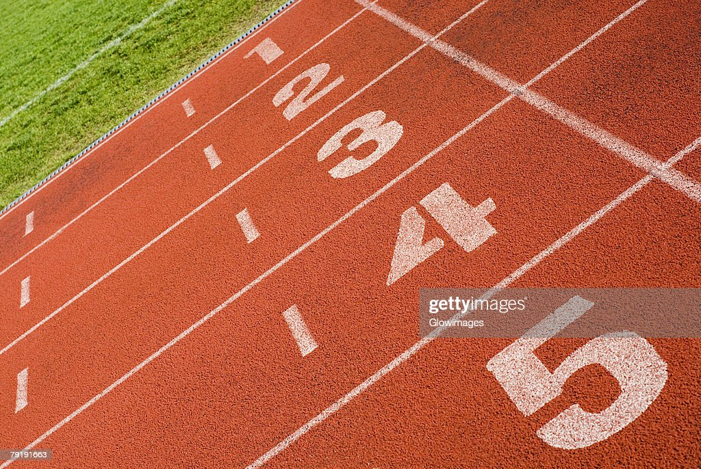 Close-up of track numbers on a running track : Foto de stock