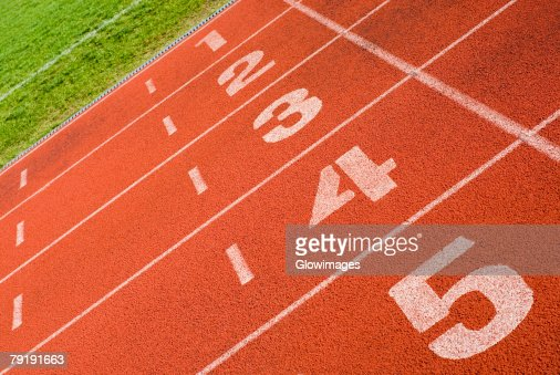 Close-up of track numbers on a running track : Stock Photo