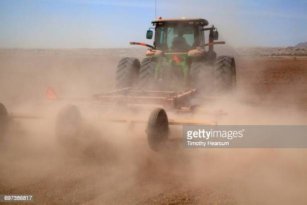 Close-up of tractor plowing and preparing field