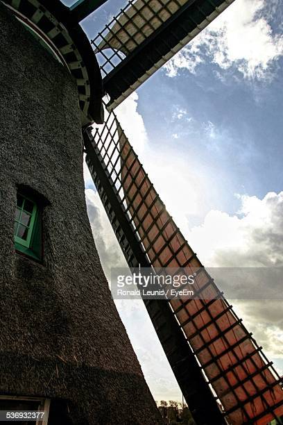 Close-Up Of Traditional Windmill Against Sky