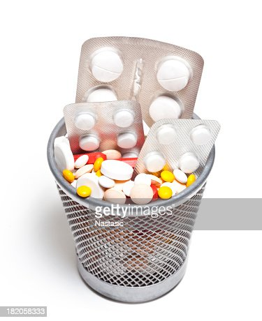 Close-up of trash can filled with a variety of pills