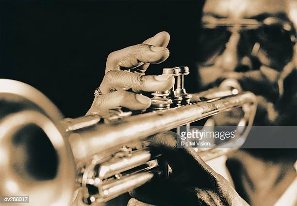 Close-up of trumpet fingering