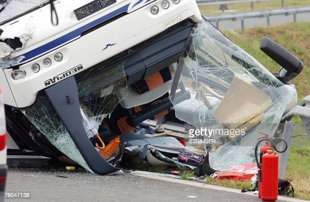 Closeup of twisted debris emerging from the overturned coach on a bend on a highway in Karlovac Croatia early 10 August2007 Two passengers died as a...