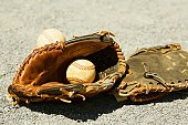 Close-up of two baseball gloves and two baseballs