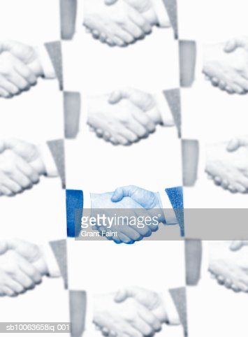 Close-up of two business men shaking hands (montage) : Stock Photo