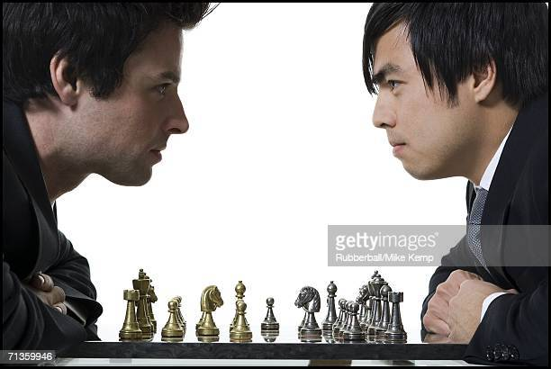 Close-up of two businessmen playing chess