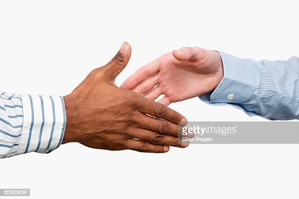 Close-up of two businessmen's shaking hands