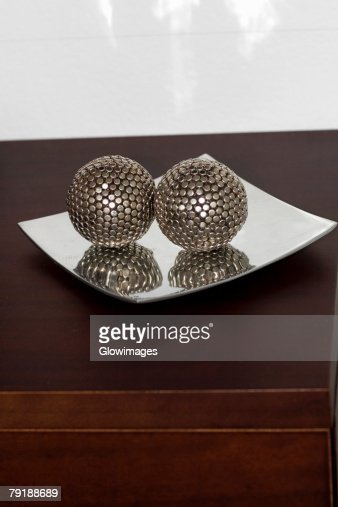 Close-up of two decorative balls in a tray : Stock Photo