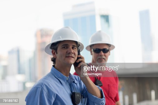 Close-up of two male construction workers at a construction site : Foto de stock