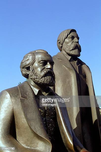 Close-up of two statues, Marx and Engle statues, Berlin, Germany