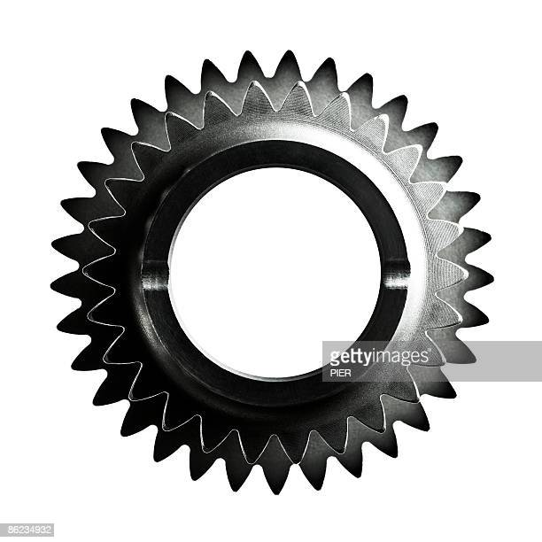 Close-up of two steel gears / cogs on white backgr