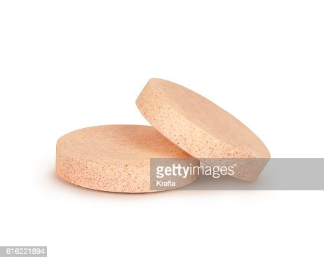 close-up of two vitamins pills isolated on white background : Stock Photo