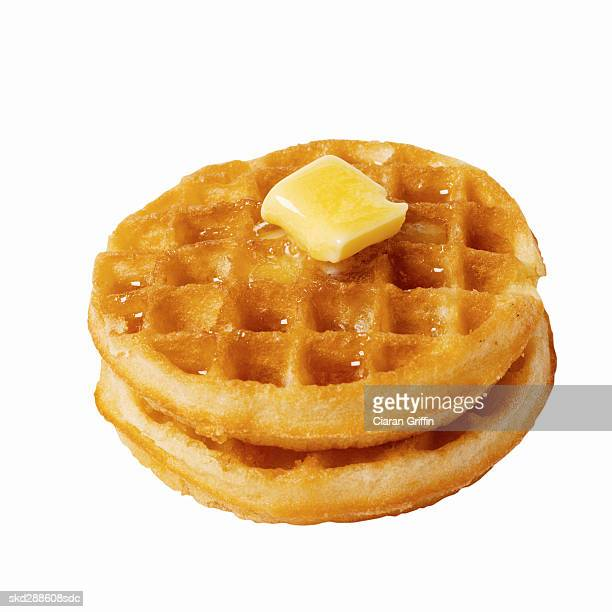 Close-up of two waffles with butter melting