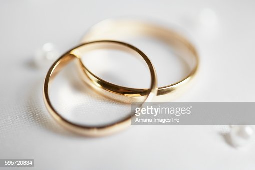 Two Wedding Rings On Ribbon Stock Photo