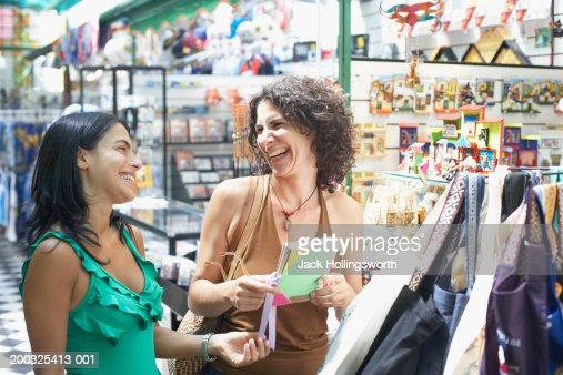 Close-up of two young women smiling in a gift store