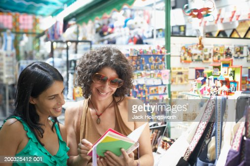 Close-up of two young women standing in a gift store
