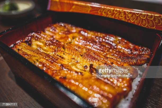 Close-Up Of Unagi Eel In Container On Table