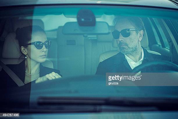 Close-up of upper class couple in the car