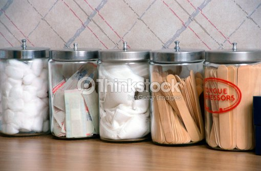 A Close Up Of Various Medical Supplies In Canisters At Doctor S Office Stock