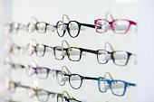 Close-up of various spectacles on display in optical store