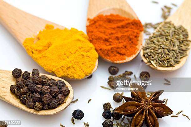 Close-up of various spices in wooden spoons