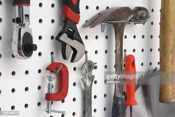 Close-up of various tools hanging