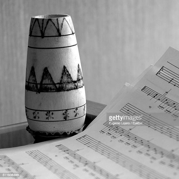 Close-up of vase with musical note