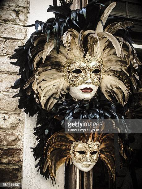 Close-Up Of Venetian Masks On Wall