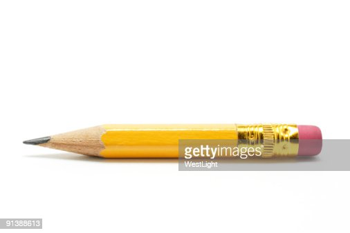 Close-up of very short yellow pencil on white background : Stock Photo