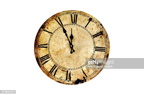 Close-Up Of Vintage Clock Against White Background