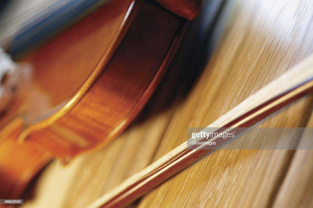 Closeup of violin and bow on wooden table stock