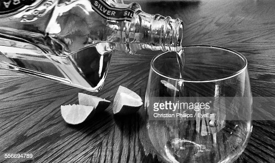 Close-Up Of Vodka Pouring In Glass