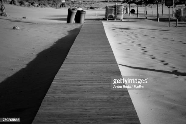 Close-Up Of Walkway On Sand At Beach