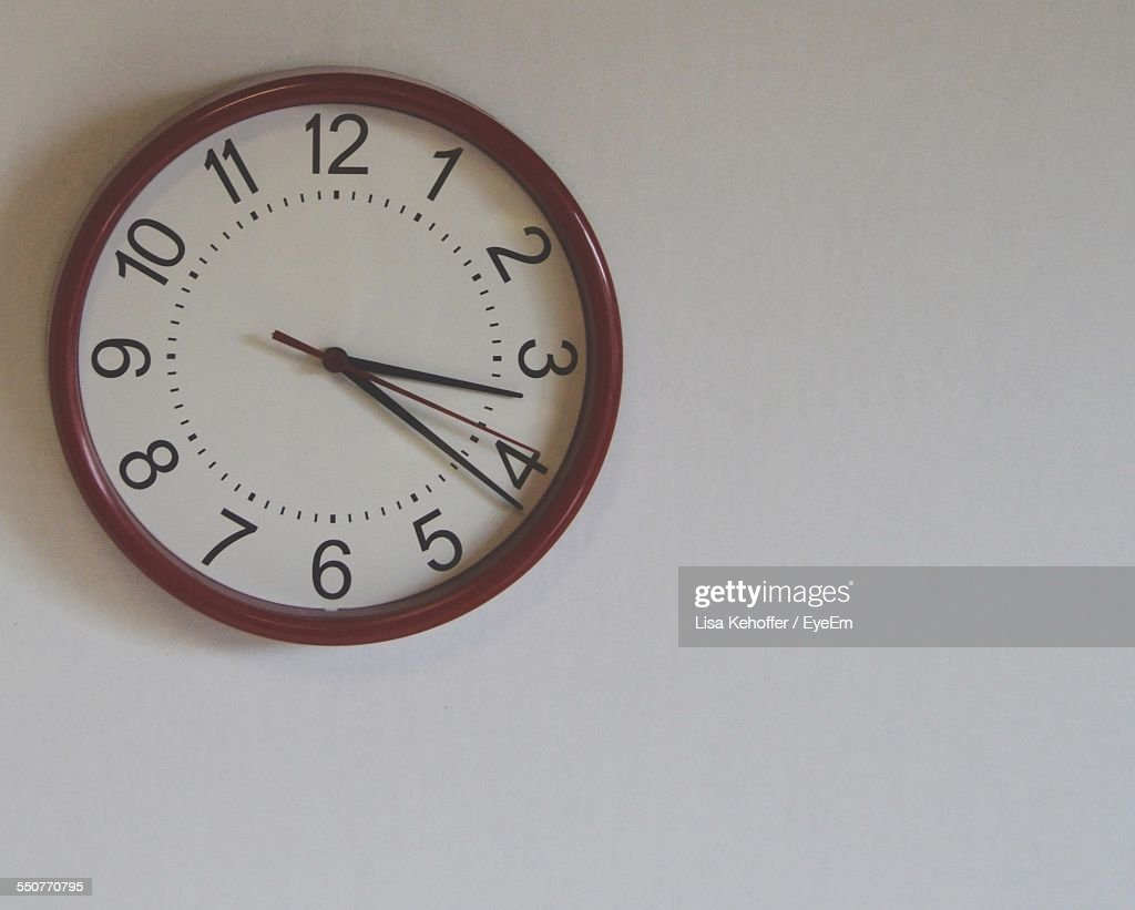 Close-Up Of Wall Clock Over White Background