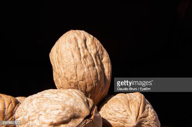 Close-Up Of Walnut Against Black Background