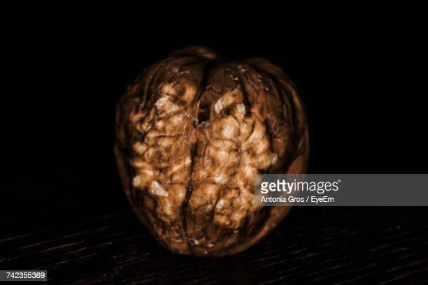 Close-Up Of Walnut Over Black Background
