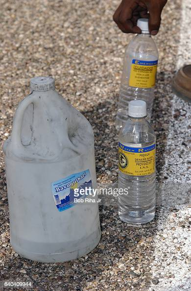 Closeup of water bottles on the road near Tucson Arizona July 8 2002 The bottles at right were supplied by US Border Patrol agents to supliment the...