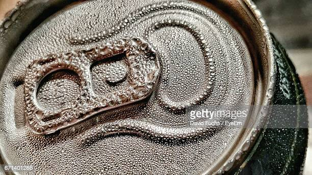 Close-Up Of Water Drops On Beer Can
