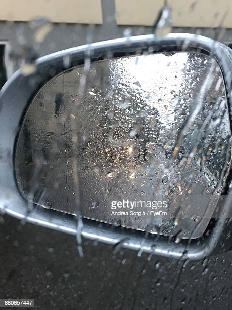 Close-Up Of Water Drops On Rear View Mirror