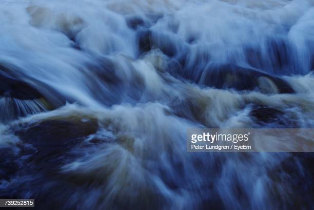 Close-Up Of Water Flowing In River