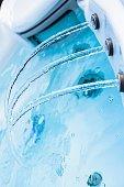 Closeup of water in hot bath tubs at spa