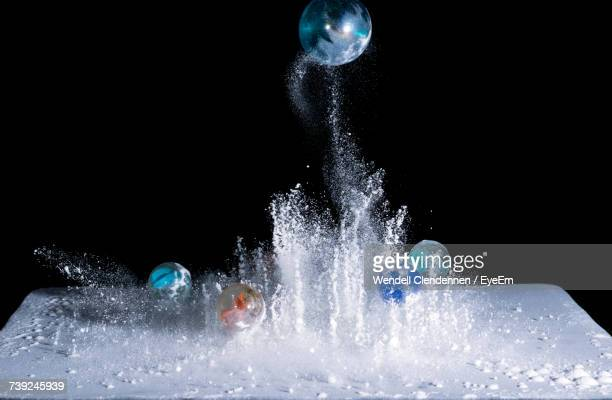 Close-Up Of Water Splashing Against Black Background